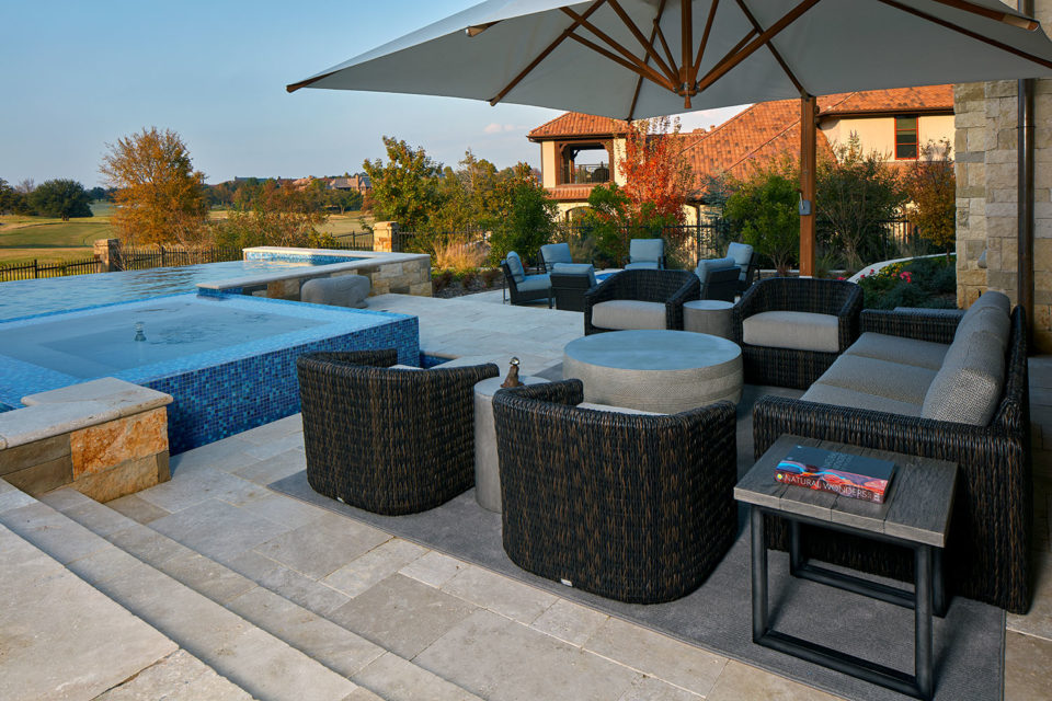 Poolside Seating Area with Barrel Chairs and Large Umbrella