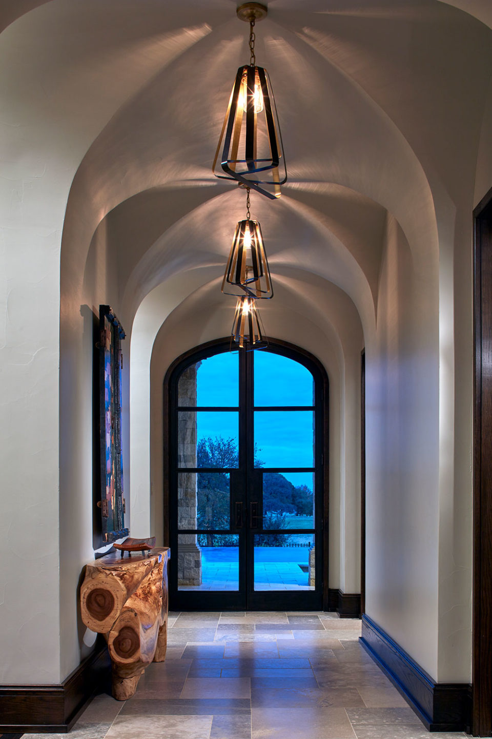 Groin Vault Ceiling with Open-Shade Light Fixtures and Natural Wood Console
