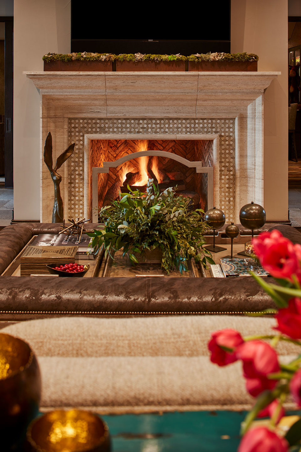 Stone Fireplace with Tile Surround and Herringbone Brick Fire Box