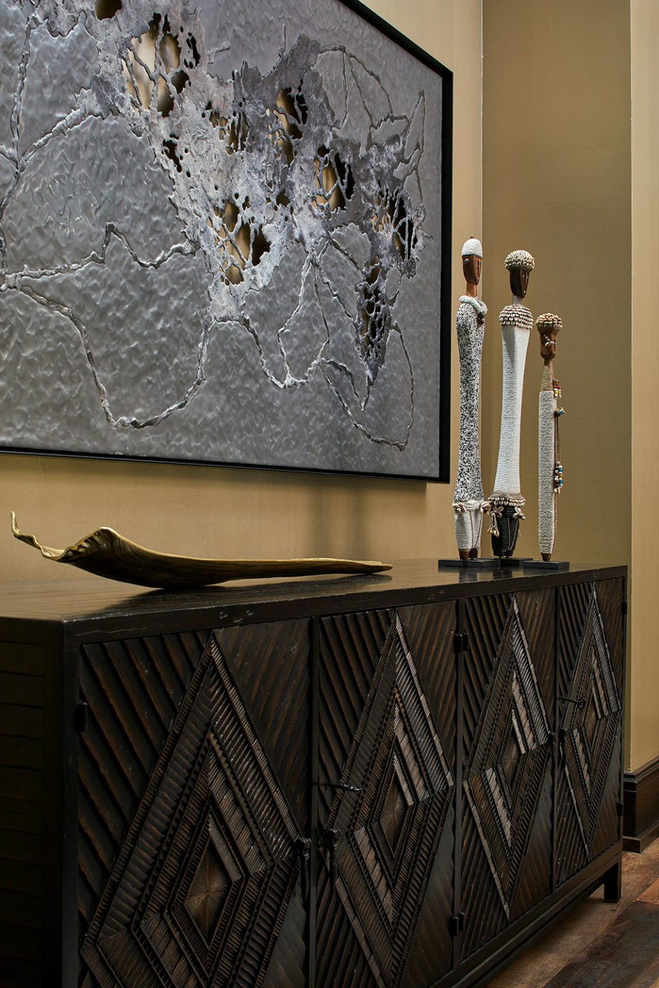 Contemporary and African Artwork on Carved Dining Room Chest