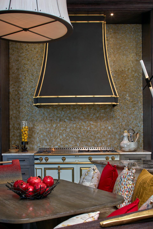 Custom Bronze Range Hood with Gold Trim on Glass Mosaic Wall