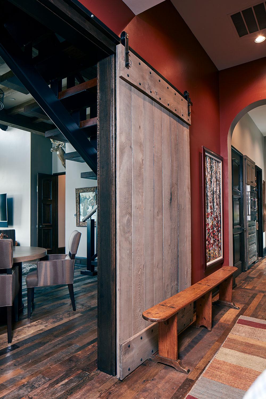 rustic hallway with barn door opening