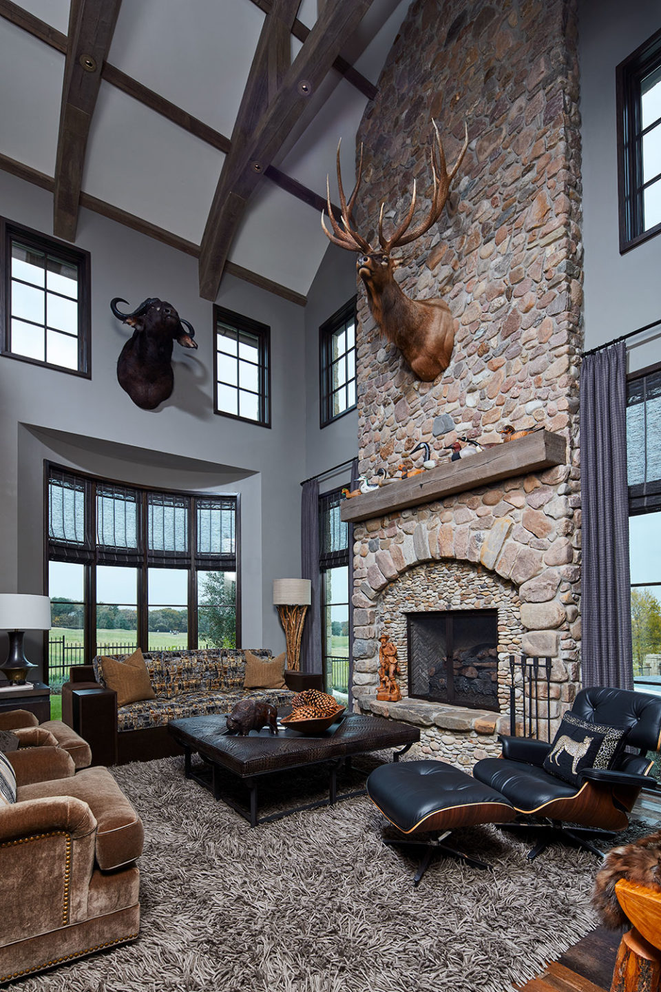 Lodge-like Office/Study/Entertainment Room with Two-Story Stone Fireplace