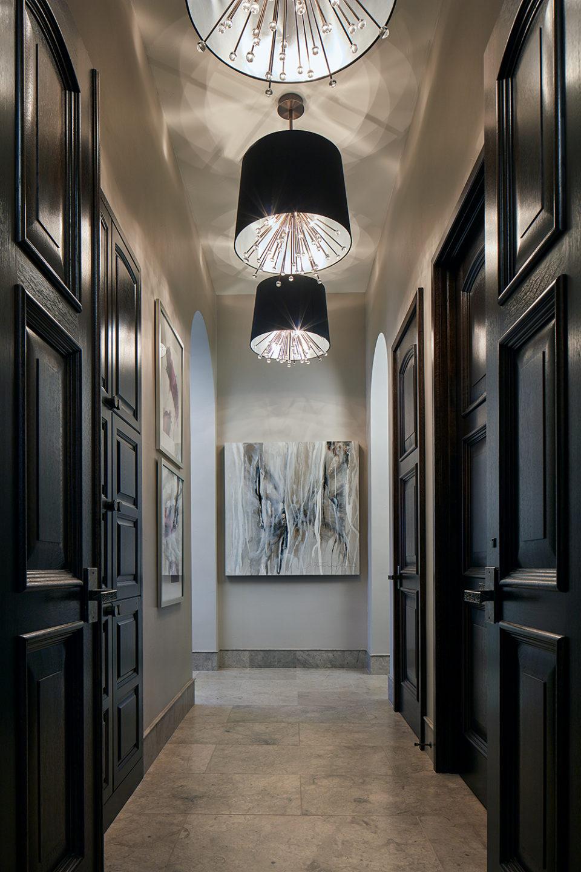 Master Bedroom Hallway with Three Drum Chandeliers