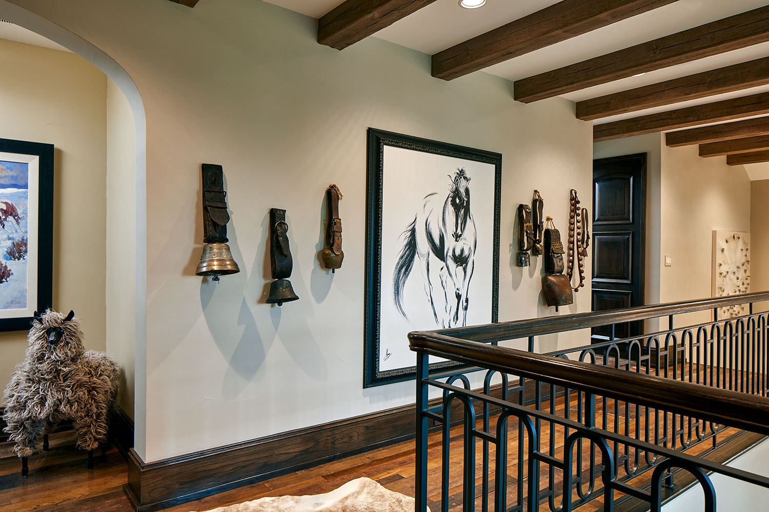 Upper Hallway with Wood Beam Ceiling, Cow Bell Collection