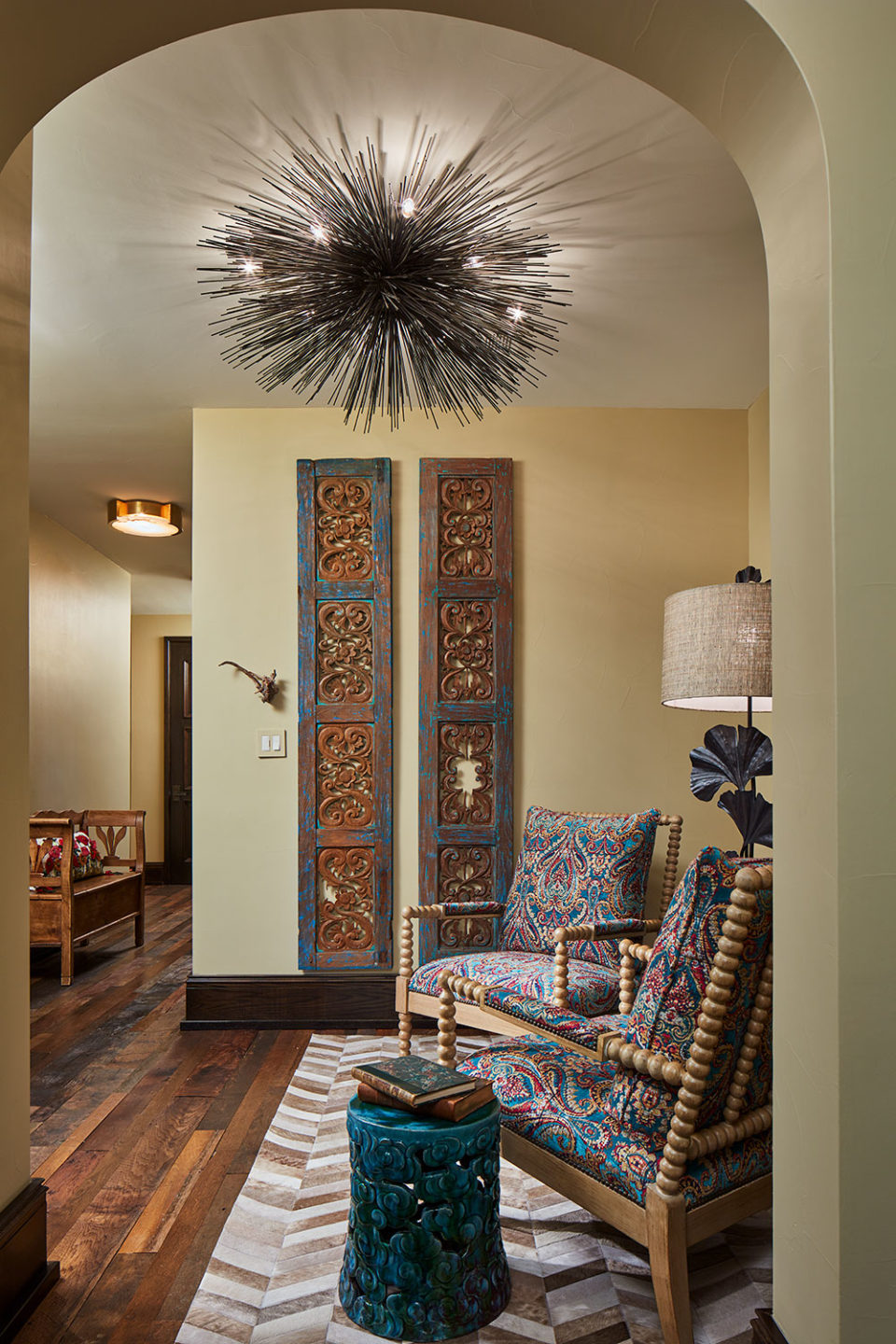 Upper Hallway Sitting Area with Paisley Chairs and Dramatic Light Fixture