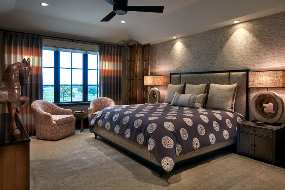 Brown and Taupe Bedroom with Swivel Lounge Chairs and Color-Block Window Panels