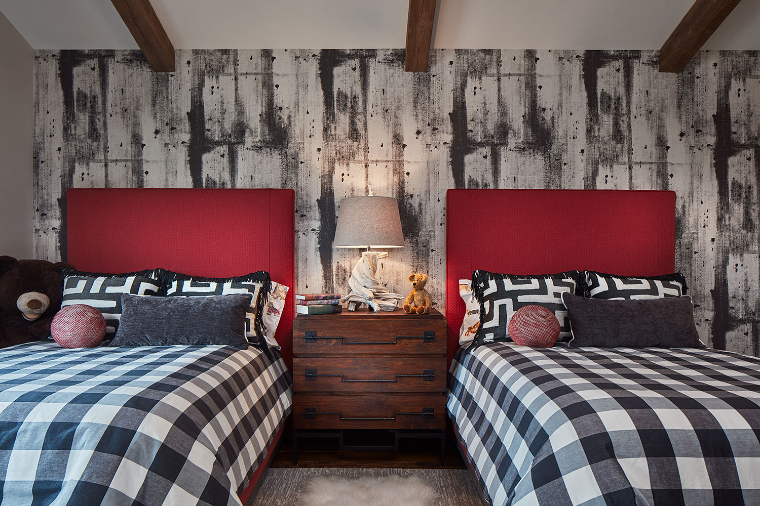 twin beds with red headboard and black and white plaid bedspread