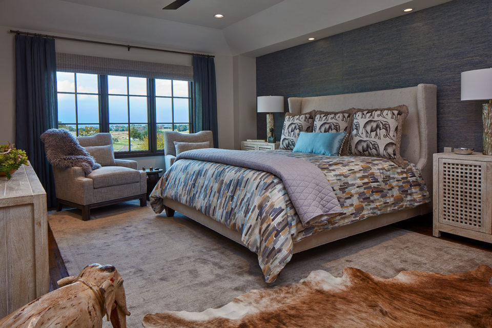 Blue and Beige Bedroom with Cow Hide Rug and Elephant Accents