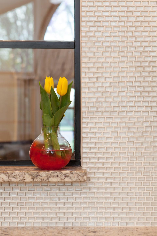 Textural Mosaic Tile Backsplash with Granite Shelf