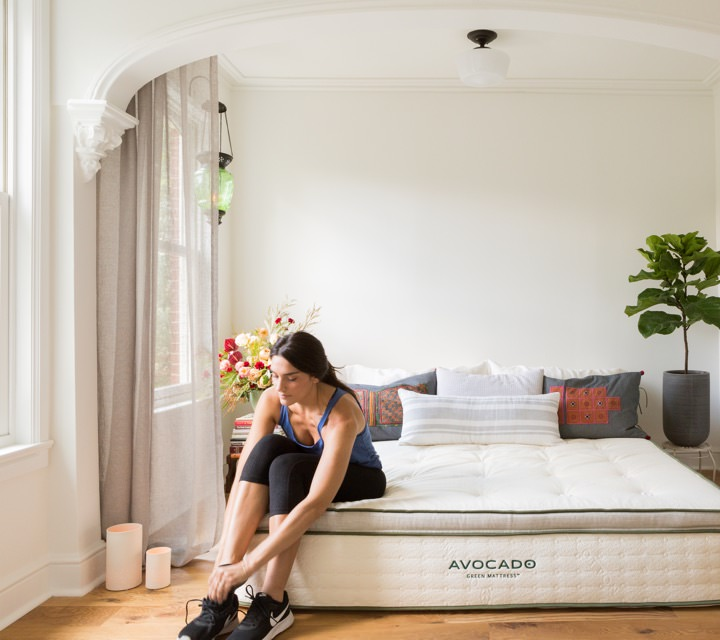 avocado mattress with woman tying her show