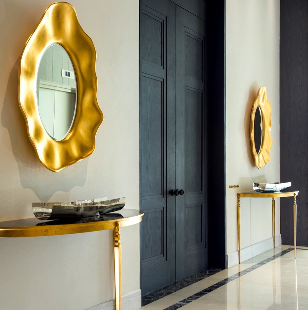 pair of christopher guy mirrors in entry hall