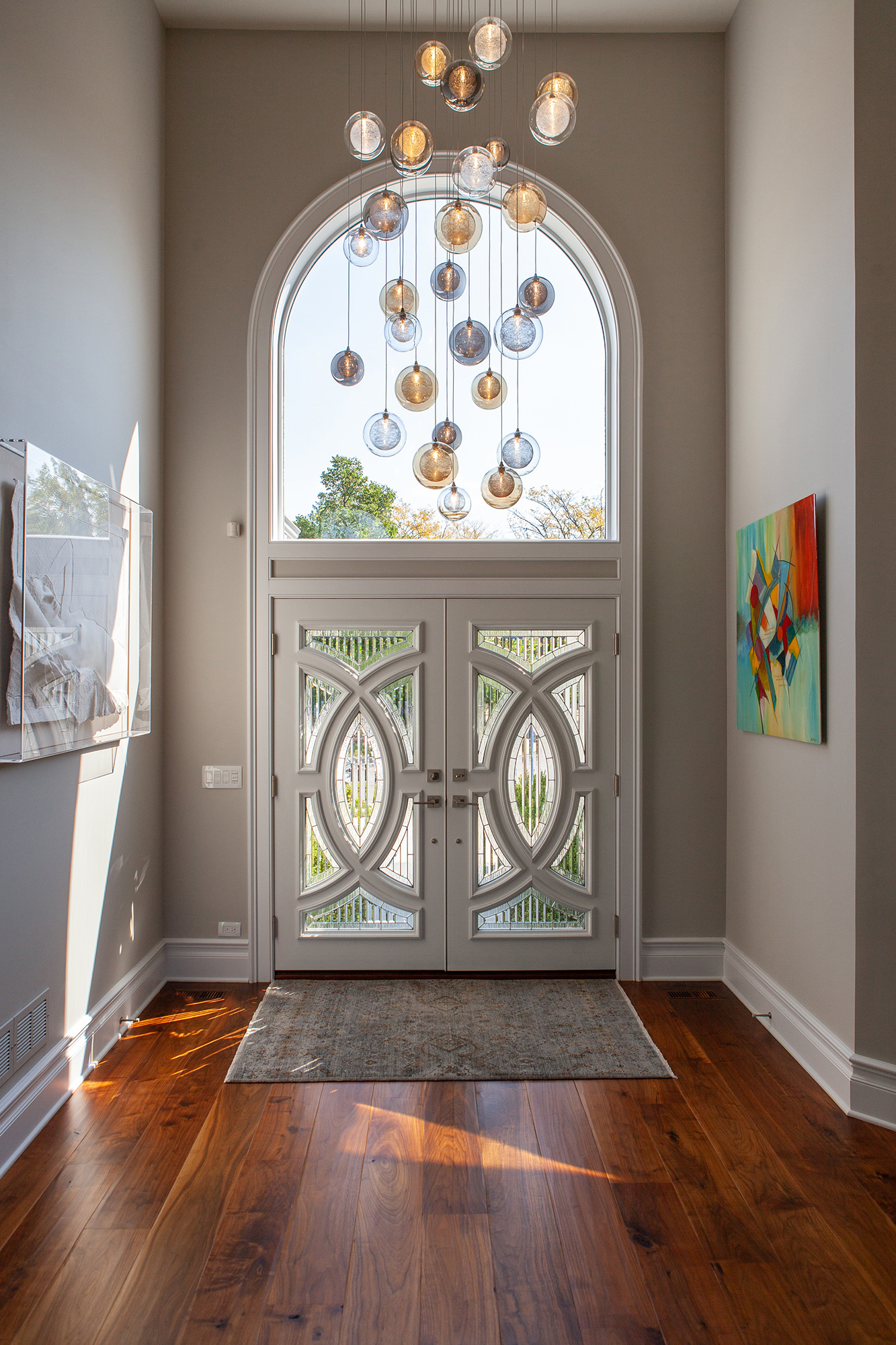 multi color glass chandelier in front entry
