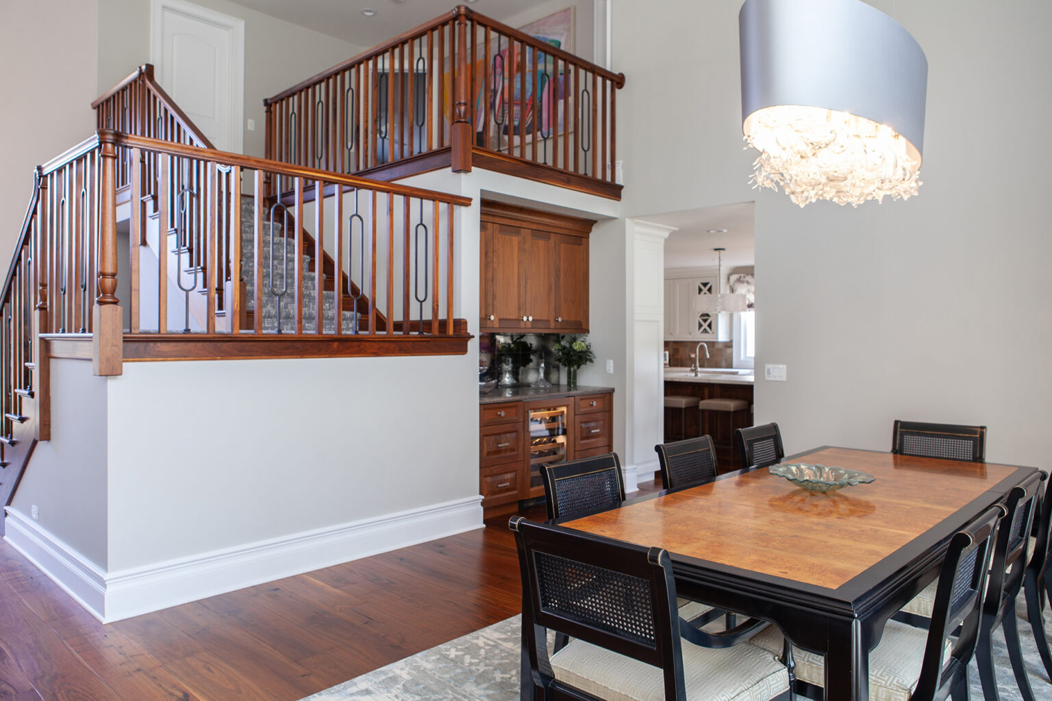 dining room with open staircase in background
