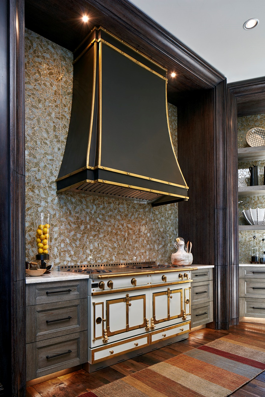 Full-wall, art-inspired backsplashes balance the rustic look of the sustainable eucalyptus cabinets and repurposed French farm house wood floor.