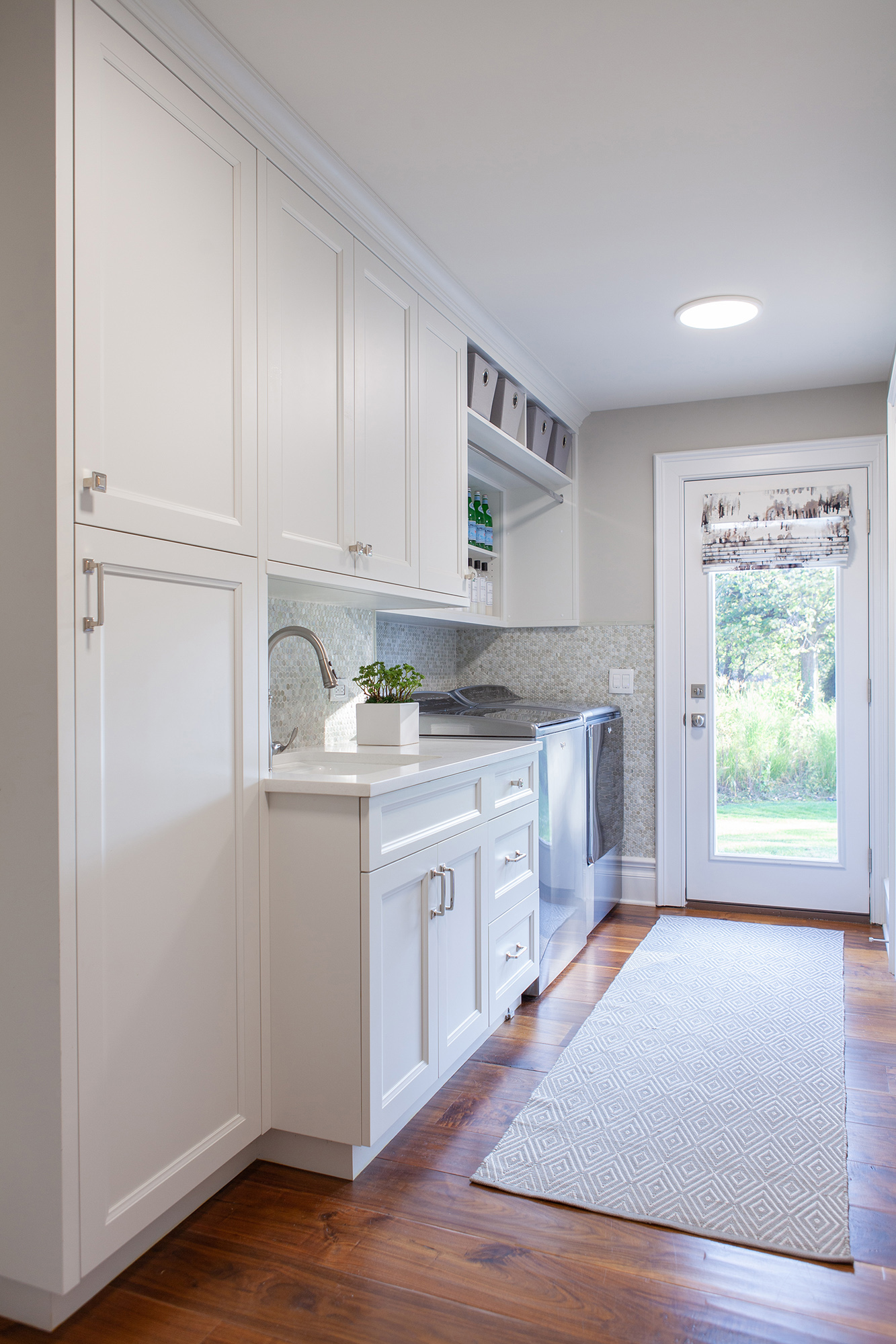 laundry room with white cabinetry