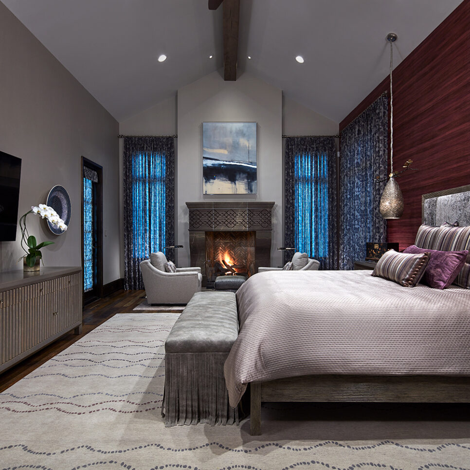 master bedroom with fireplace and designer bed