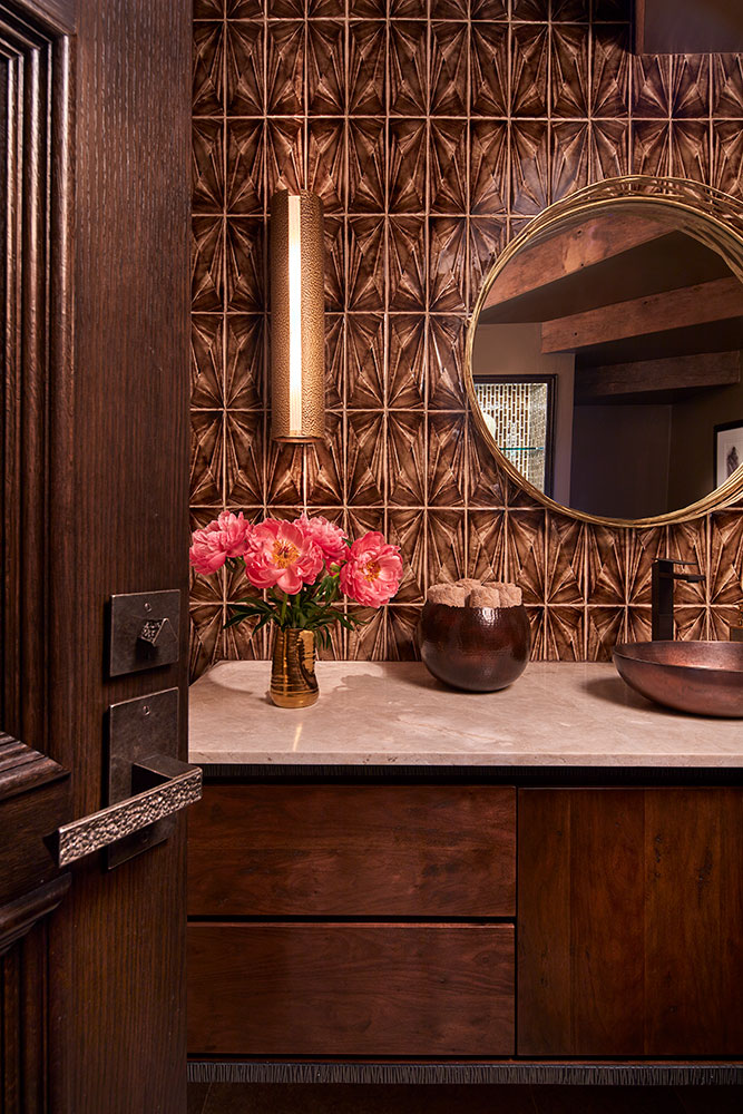 powder room with metallic tile backsplash