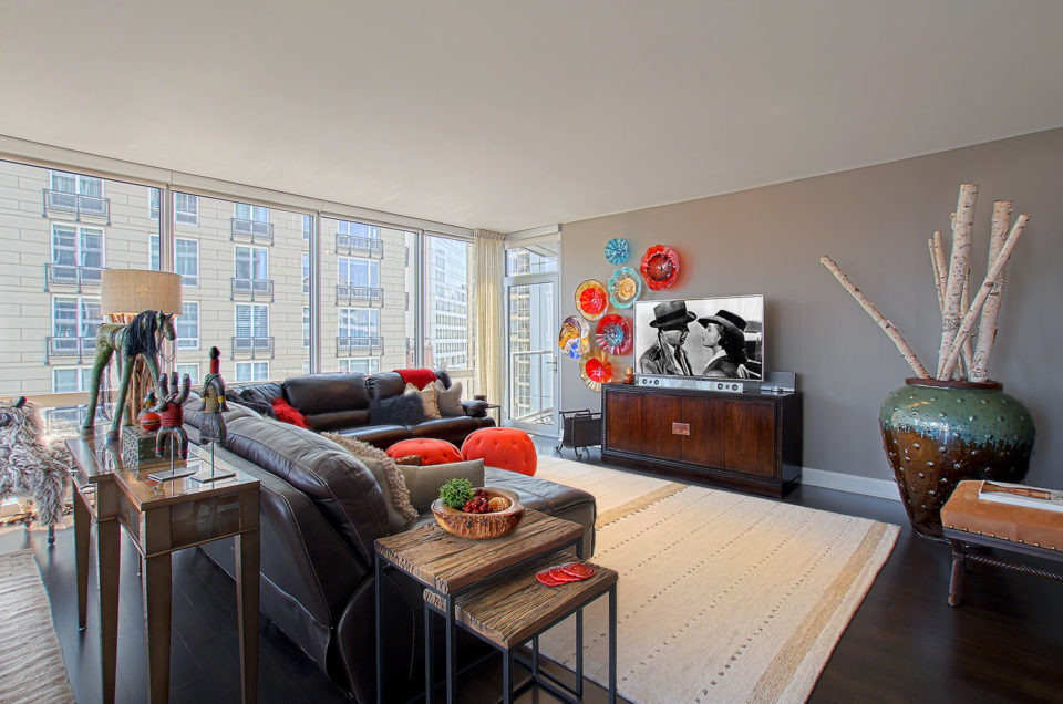 Leather Sectional, Nesting Tables and Over-sized Urn in Great Room
