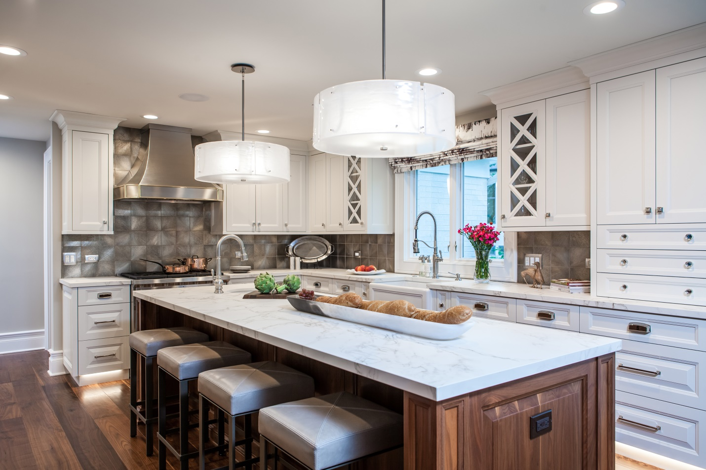 opaque qhite glass pendants over kitchen island