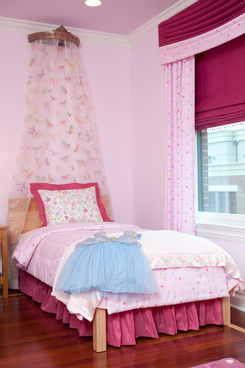 pink bedroom with crown top