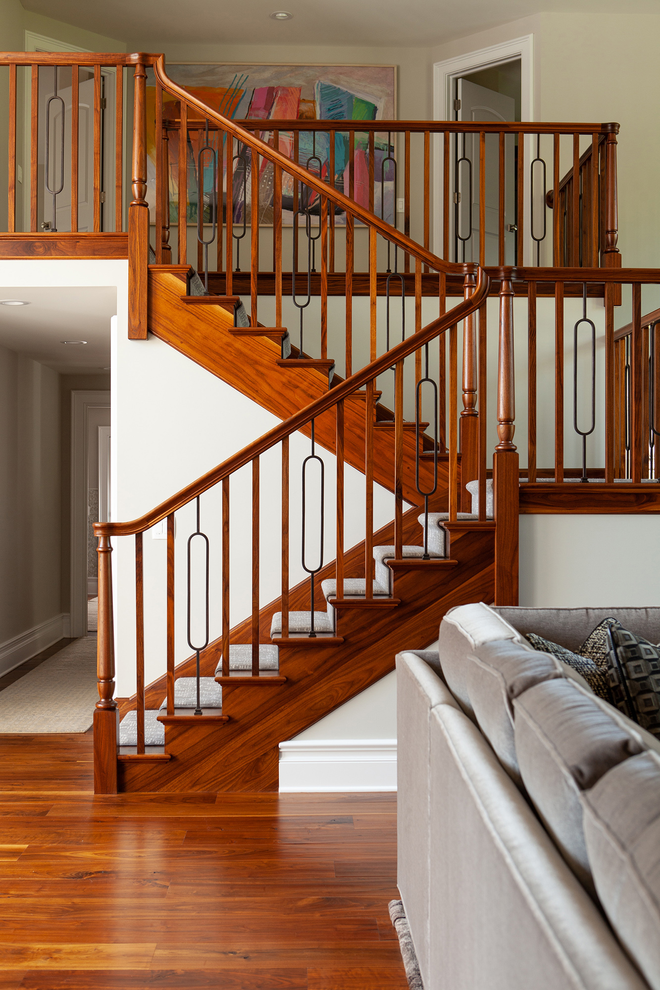 staircase with metal and wood ballusters