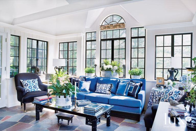 sunroom-black-windows-blue-sofa-luxe-magazine